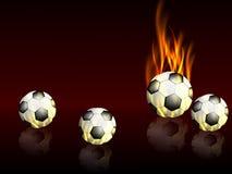 Fondo de los deportes con los balones de fútbol con reflexiones y llamas Foto de archivo libre de regalías
