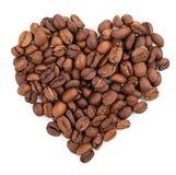 Fondo de los granos de café presentado bajo la forma de corazón fotografía de archivo