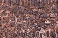 Fondo de los guijarros de la roca del río en piso Foto de archivo libre de regalías