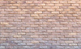 Fondo de los ladrillos de revestimiento amarillos Cierre del alivio de los ladrillos para arriba Foto de archivo