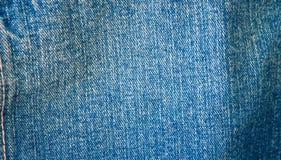 Fondo de los vaqueros, dril de algodón con la costura del diseño de la moda Vieja textura de la vendimia del grunge Imagen de archivo