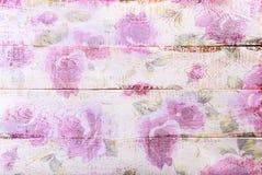 Fondo de madera blanco con el estampado de flores Imagenes de archivo