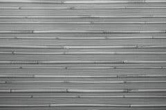 Fondo de madera caliente natural con el bambú y la paja Imagen de archivo