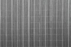 Fondo de madera caliente natural con el bambú y la paja Fotografía de archivo