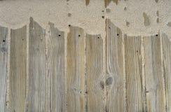 Fondo de madera con la arena Imagen de archivo libre de regalías