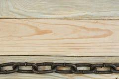 Fondo de madera con la cadena Copie el espacio para el texto imagen de archivo libre de regalías