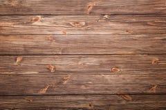 Fondo de madera de Brown con los nudos Foto de archivo libre de regalías