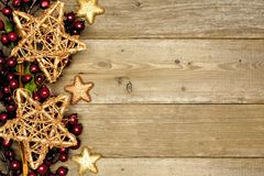 Fondo de madera de la Navidad con la frontera de la estrella Imagen de archivo libre de regalías