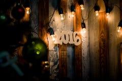 fondo de madera de la Navidad del número de 2016 años Imagen de archivo libre de regalías