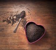 Fondo de madera del corazón del té Foto de archivo