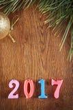 Fondo de madera del día de fiesta de la Feliz Año Nuevo 2017 Fotos de archivo