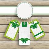 Fondo de madera del emblema de Pascua de las etiquetas engomadas blancas del precio Fotografía de archivo libre de regalías