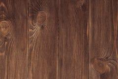 Fondo de madera oscuro de la textura de la pared del tablón de Brown Fotografía de archivo libre de regalías
