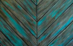 Fondo de madera verde, tablones de madera naturales lamentables con los puntos borrosos del color verde, textura del entarimado v Foto de archivo libre de regalías