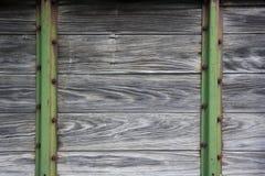 Fondo de madera y del metal de la maquinaria de granja vieja Imagen de archivo libre de regalías
