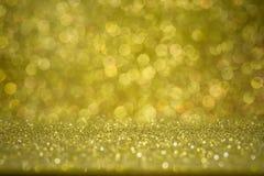 Fondo de oro abstracto del bokeh Día de fiesta hermoso Foto de archivo libre de regalías