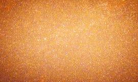 Fondo de oro anaranjado del brillo del Año Nuevo de la Navidad Tela de la textura del extracto del día de fiesta Elemento, flash imagen de archivo