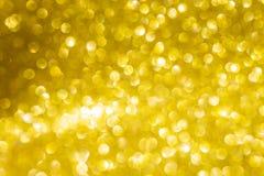 Fondo de oro brillante brillante del bokeh Foto de archivo libre de regalías