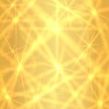 Fondo de oro con las estrellas que centellean chispeantes Fotografía de archivo libre de regalías