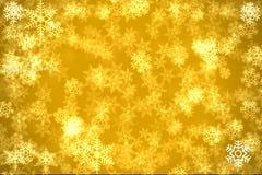 Fondo de oro con snowflakers Foto de archivo