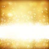 Fondo de oro de la Navidad que brilla intensamente con las estrellas, los copos de nieve y las luces Fotografía de archivo libre de regalías