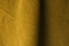 Fondo de oro de la tela del terciopelo, terciopelo, moer, efecto de la cachemira Imágenes de archivo libres de regalías