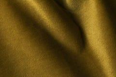 Fondo de oro de la tela del terciopelo, terciopelo, moer, efecto de la cachemira Fotos de archivo libres de regalías