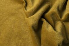 Fondo de oro de la tela del terciopelo, terciopelo, moer, efecto de la cachemira Imagen de archivo libre de regalías
