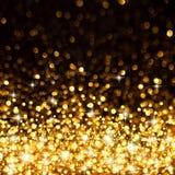 Fondo de oro de las luces de la Navidad Imagen de archivo libre de regalías