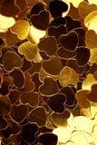 Fondo de oro de los corazones Imagenes de archivo