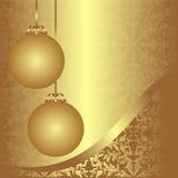 Fondo de oro de Navidad del ornamental con las bolas. Fotos de archivo libres de regalías