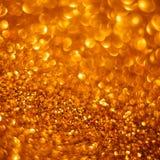 Fondo de oro del bokeh del brillo Fotos de archivo libres de regalías