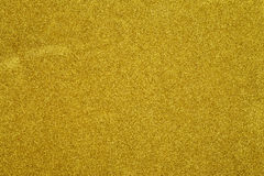Fondo de oro del extracto de la Navidad de la textura del brillo Fotos de archivo libres de regalías