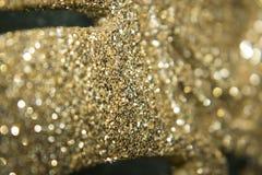 Fondo de oro del extracto de la Navidad de la textura del brillo Imagenes de archivo