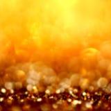 Fondo de oro del extracto de la Navidad del brillo con el SP defocused Foto de archivo