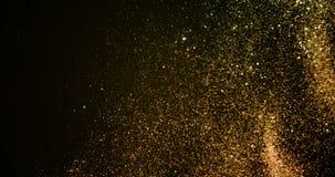 Fondo de oro de las párticulas de polvo de la explosión del brillo de la chispa de la pendiente de la Navidad con caer que fluye