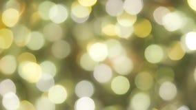 Fondo de oro que brilla intensamente borroso de la Navidad de Bokeh Luces de la Navidad Brillo del extracto del A?o Nuevo del d?a metrajes