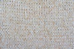 Fondo de pañerías texturizadas beige Modelo hecho punto Imagenes de archivo