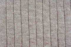 Fondo de pañerías texturizadas beige Modelo hecho punto Fotografía de archivo