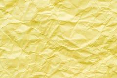 Fondo de papel amarillo arrugado de la textura Fotos de archivo libres de regalías