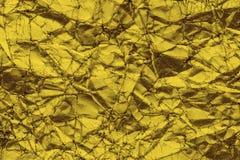 Fondo de papel arrugado de oro abstracto de la textura fotografía de archivo libre de regalías