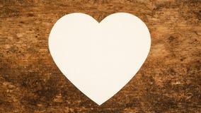Fondo de papel en blanco del corazón Despliegue y plegamiento del papel en forma de corazón en blanco
