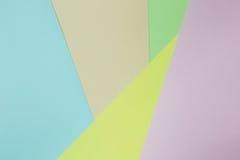 Fondo de papel geométrico abstracto Colores verdes, amarillos, rosados, anaranjados, azules de la tendencia Fotografía de archivo libre de regalías