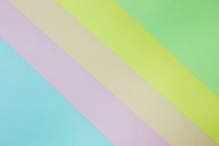 Fondo de papel geométrico abstracto Colores verdes, amarillos, rosados, anaranjados, azules de la tendencia Imagen de archivo libre de regalías