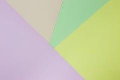 Fondo de papel geométrico abstracto Colores verdes, amarillos, rosados, anaranjados de la tendencia Fotografía de archivo