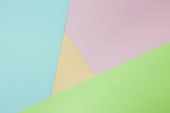 Fondo de papel geométrico abstracto Colores verdes, rosados, anaranjados de la tendencia Fotos de archivo libres de regalías