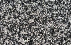 Fondo de pequeñas piedras blancas y negras imagen de archivo