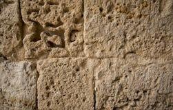 Fondo de piedra con las grietas figuradas Fotografía de archivo