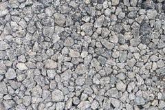 Fondo de piedra machacado de la textura del granito de la grava Fotos de archivo