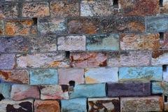Fondo de piedra multicolor del ladrillo del pórfido y de la piedra arenisca Fotografía de archivo libre de regalías